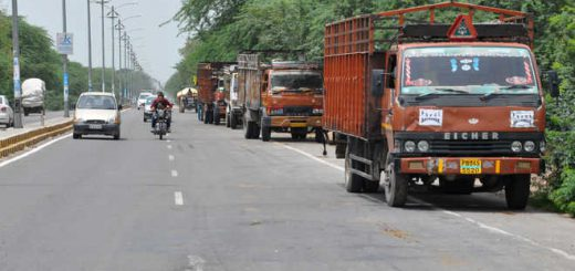 Truckers block highway to protest disbanding of unions, vow month-long stir
